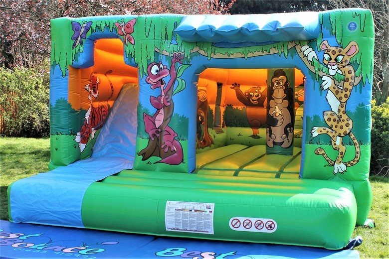 Jungle Cabin Bouncy Castle With Slide Surrey