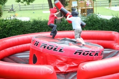 Inflatable Rock N Role Gladiator Hire