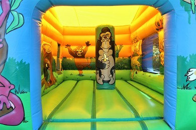 Jungle Cabin Bouncy Castle With Slide Chertsey